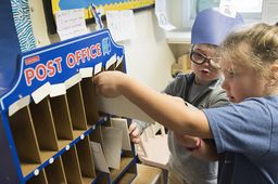 PreK students open their Post Office and practice skills while delivering smiles